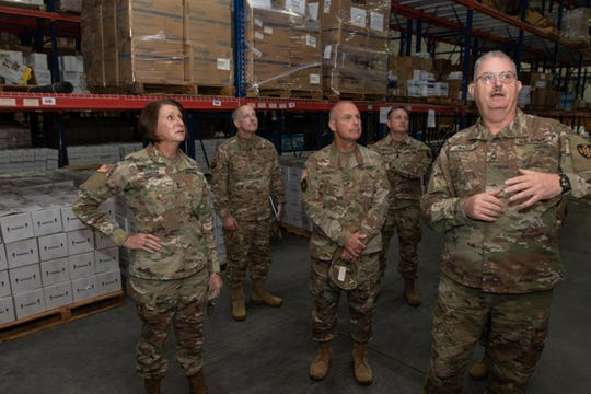 Maj. Gen. Sheryl Gordon, Alabama National Guard adjutant general, and command team tour the Alabama Department of Public Health Warehouse where Guardsmen are partnering with ADPH workers to make COVID 19 test kits in Montgomery, Alabama, April 22, 2020.