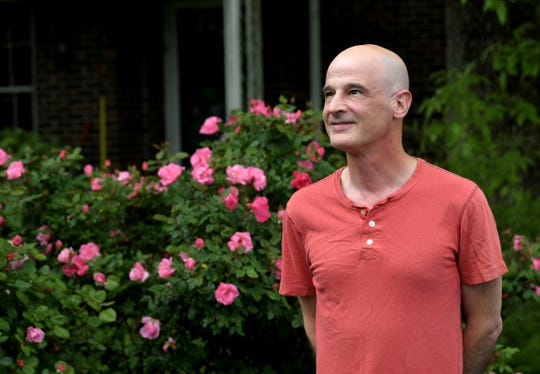 Tom Bailey stands outside his East Nashville home on Saturday, April 25, 2020. Bailey, who is a small-business owner, filed a complaint with the state against K&S World Market in Nashville and accused the store of selling face masks for approximately $50.