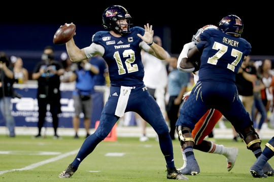 FIU quarterback James Morgan (12) stands back to pass during the first half of an NCAA college football game against Miami, Saturday, Nov. 23, 2019, in Miami.