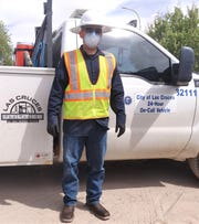 Las Cruces Utilities Water Line Maintenance associate Jaime Romero in full PPE — mask, gloves, and eye protection. This allows him to keep himself, co-workers and LCU customers safe.