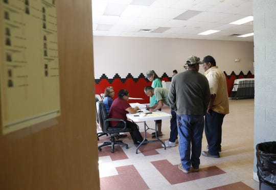 Voters form a line to receive ballots during the Navajo Nation primary election on Aug. 30, 2016 at the Tsé Daa K'aan Chapter house in Hogback.