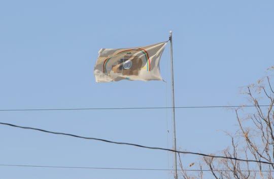 The Navajo Nation flag flies in April in Shiprock.