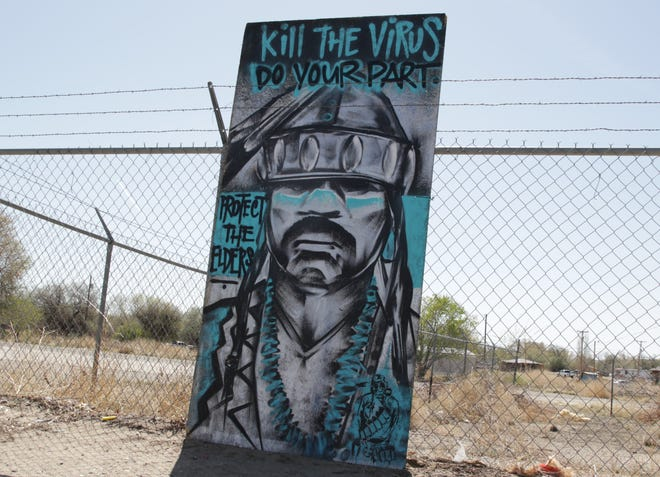 A piece of artwork reminds community members to stay at home on April 25 in Shiprock. The Navajo Nation is under a weekend curfew to combat the spread of the coronavirus.