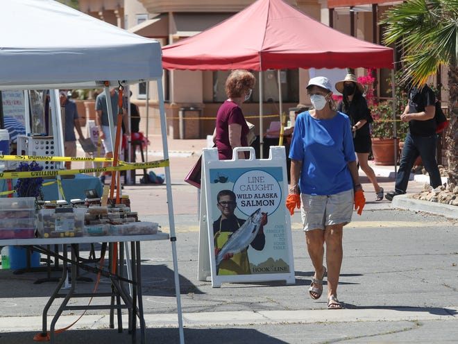 People shop and keep their social distance at the Certified Farmers' Market in Palm Springs in the morning before temperatures reached into triple digits, April 25, 2020.