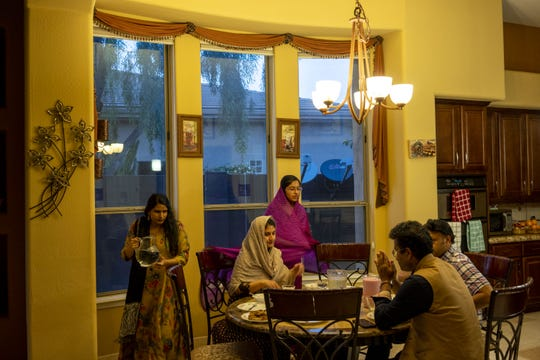 Ariff family breaks their fast during the first day of Ramadan at their home in the West Valley.