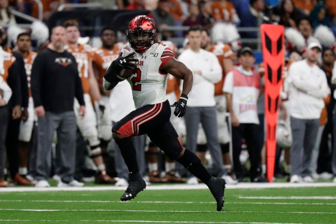 Utah running back Zack Moss (2) carries against Texas during the first half of the Alamo Bowl NCAA college football game in San Antonio, Tuesday, Dec. 31, 2019. (AP Photo/Eric Gay)