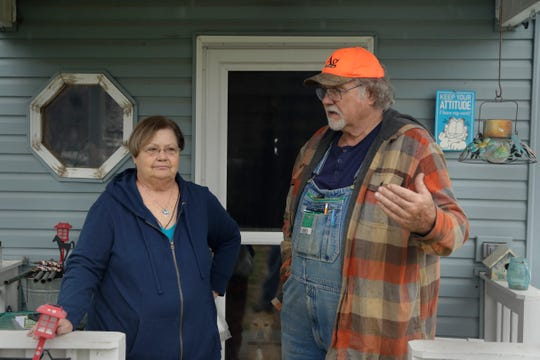 Dennis and his wife, Sharon talk on the front porch of their home near Troy, Kan. Friday, April 24, 2020. Dennis, a retired farmer, shipped one of the couple's five N-95 masks to New York Gov. Andrew Cuomo for use by a doctor or a nurse.