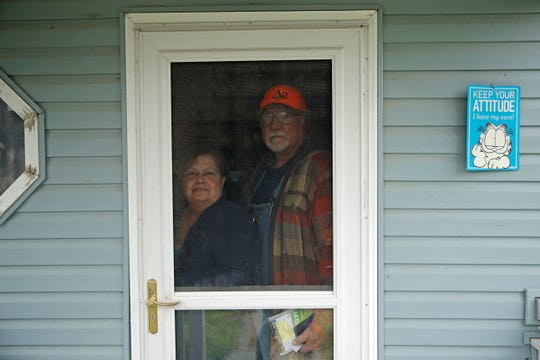 Dennis and his wife, Sharon stand inside their home Friday, April 24, 2020, near Troy, Kan. Dennis, a retired farmer, shipped one of the couple's five N-95 masks to New York Gov. Andrew Cuomo for use by a doctor or a nurse.