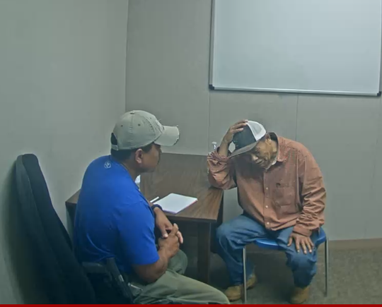 Nouan Mokthephathai, right, is interviewed by an investigator on April 24, 2020.
