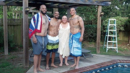 (l-r) Brothers Jace Prescott, Tad Prescott and Dak Prescott with their mother, Peggy.