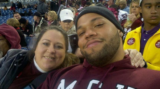 Jace Prescott and his mother, Peggy, at a Mississippi State football game.