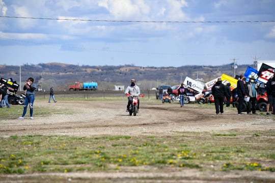 Jack Croaker drives his motorbike through the grounds of  Park Jefferson Speedway on Saturday, April 25, in Jefferson, S.D. The racing event is going on without fans present because of the coronavirus pandemic.