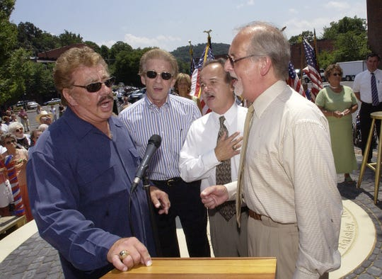 The Statler Brothers, Harold Reid, left, Phil Balsley, Jimmy Fortune and Don Reid, sing America the Beautiful at the close of the July 2002 dedication of a monument to the group along Johnson Street at the Wharf in downtown Staunton.