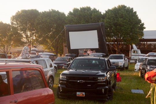 Community members gather at Staheli Family Farm for a drive-in movie Friday, April 24, 2020.