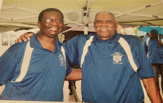 """Sam Graham poses with his former football coach James """"Billy"""" Oliver. The player-coach duo were members of the old Lincoln High School team."""