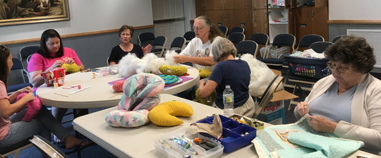 Members of The Church of Jesus Christ of Latter-day Saints, from left, Brittany Dransfield, Megan Copelin, Ann Nicholson, Trudie Bell, Maryalice Baumann and Diane Remsen, work on community service projects.