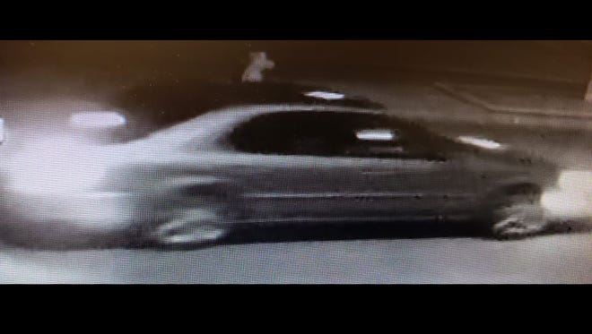 This still from a surveillance camera depicts a possible suspect and vehicle believed to be involved in a series of vehicle vandalism incidents in Camarillo last week.