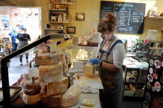 Heather Kelly, cheesemonger at Paradise Pantry in Ventura, prepares an order of cheese to go. The combination restaurant, cheese counter and wine shop is preparing for its first Sunday brunch since switching to takeout service with curbside delivery. Orders are due May 7 for the special Mother's Day menu.