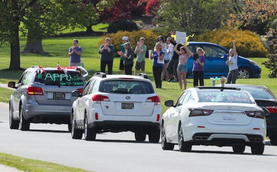 High school seniors - along with some college seniors - parade Saturday through the Back Creek neighborhood near Middletown in celebration of their pending graduations. More than 50 students from about 10 schools participated in the informal recognition of their milestones.