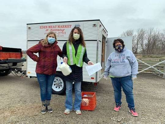 The Waupun FFA and FFA Alumni, with the help of a local anonymousdonor, gave away 1,200 gallons of milk in the Waupun Area School District on April 24. Pictured are, from left,  Mackenzie Chitko, Ag/Tech Teacher at Waupun High School, Tiffany Sponholz, Waupun High School Assistant Principal and Tari Costello, Agriculture Education Teacher at Waupun High School.