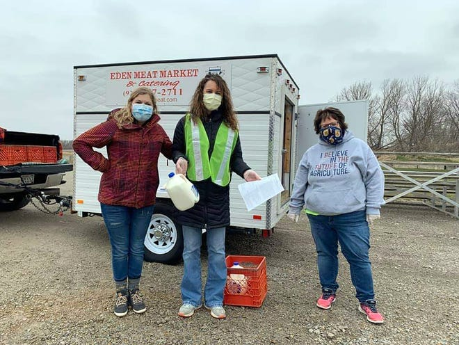 The Waupun FFA and FFA Alumni, with the help of a local anonymous donor, gave away 1,200 gallons of milk in the Waupun Area School District on April 24. Pictured are, from left,  Mackenzie Chitko, Ag/Tech Teacher at Waupun High School, Tiffany Sponholz, Waupun High School Assistant Principal and Tari Costello, Agriculture Education Teacher at Waupun High School.