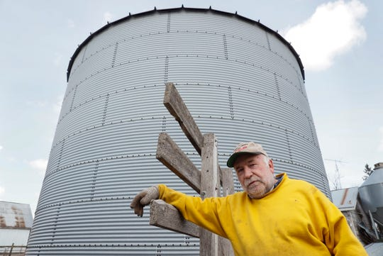 In this Friday, April 17, 2020, photo, Chris Petersen poses for a photo as he stands near a feed storage bin on his hog farm near Clear Lake, Iowa. COVID-19, the disease caused by the coronavirus, has created problems for all meat producers, but pork farmers have been hit especially hard.