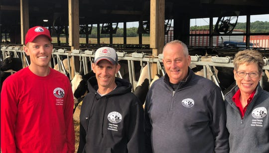 Wisconsin dairy farmers Lloyd and Daphne Holterman, and their partners Tim Strobel and Jordan Matthews, Rosy-Lane Holsteins, won a national award for Outstanding Dairy Farm Sustainability. Pictured from left to right are Jordan Matthews, Tim Strobel, Lloyd Holterman and Daphne Holterman.
