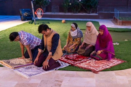 The Ariff family prays at their Phoenix home on the first day of Ramadan. Due to COVID-19, the family is praying at their home instead of going to their mosque.