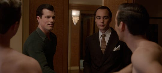 Rock Hudson (Jake Picking), second left, gets an introduction to the casting-couch side of talent agent Henry Willson (Jim Parsons) in Netflix's 'Hollywood.'