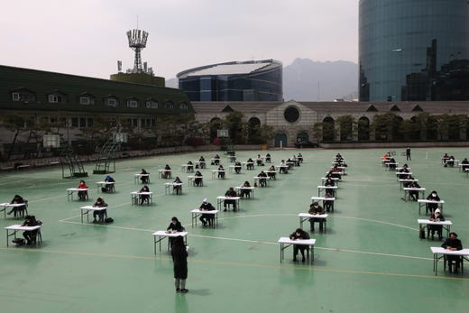 South Koreans wear masks and sit according to social distancing as a preventive measure against the coronavirus (COVID-19), as they prepare for an insurance planner examination of General Insurance Association of Korea at Seokyeong University playground on April 25, 2020 in Seoul, South Korea. South Korea has called for expanded public participation in social distancing, as the country witnesses a wave of community spread and imported infections leading to a resurgence in new cases of COVID-19. According to the Korea Center for Disease Control and Prevention, 10 new cases were reported. The total number of infections in the nation tallies at 10,718.