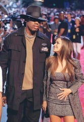 1998: Dennis Rodman and Carmen Electra arrive at the opening of the Planet Hollywood restaurant in Montreal.