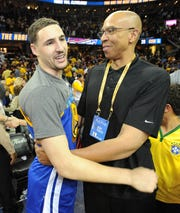 Mychal Thompson, right, embraces his son Klay after the Golden State Warriors won the NBA title in 2015.