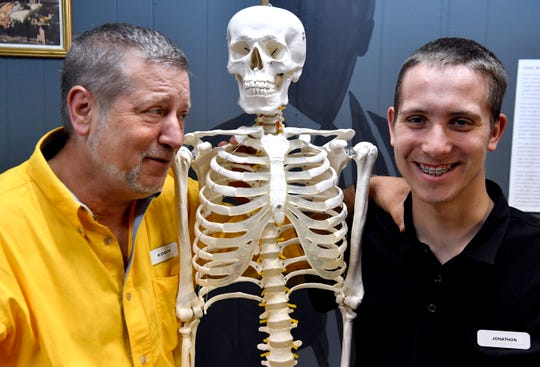 Eddy Weiss (left) and his son Jonathon with a friend at the National Health and Public Safety History Museum in Dublin March 14. Jonathon is the museum's curator.