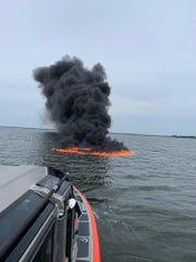 A burning boat sank Sunday afternoon in the Indian River near Titusville.