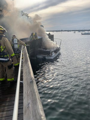 Smoke billows from a burning boat Wednesday at Doc's Bait House on Merritt Island.