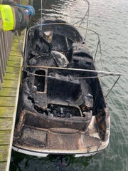 Flames scorched a small boat Wednesday at Doc's Bait House on Merritt Island.