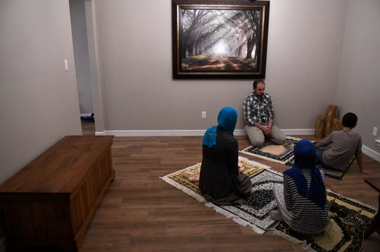 The Abu-Baker family prays on the second night of Ramadan, Saturday, April 25, 2020, in their home. Like many other families who are Muslim in the Coastal Bend, the Abu-Baker's adjust their traditions for the holy month because of coronavirus and social distancing.