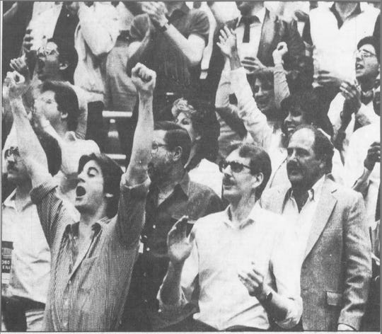 Detroit Pistons fans cheer during Game 5 of the Eastern Conference quarterfinals vs. the New York Knicks at a sold-out Joe Louis Arena, April 27, 1984.