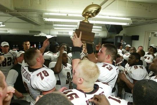Central Michigan offensive lineman Joe Staley hoists the MAC championship trophy after the win over Ohio on Nov. 30, 2006, at Ford Field.