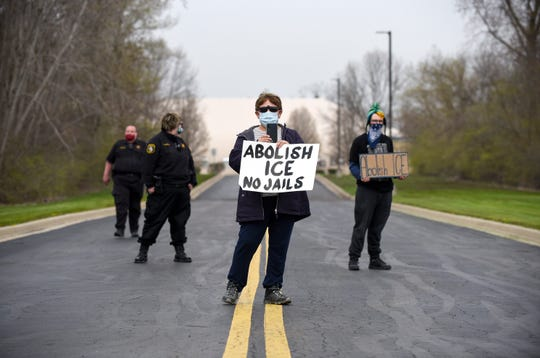 Monroe County Sheriff's deputies block protestors from entering the grounds of the Monroe County Inmate Dormitory Facility in Monroe, Mich., Friday, April 24, 2020.