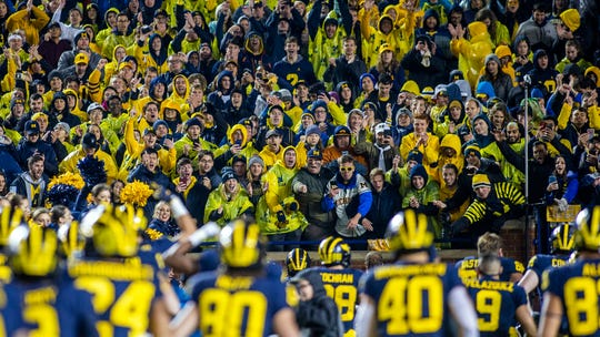 Michigan Stadium is one such venue where fans are packed in close together.