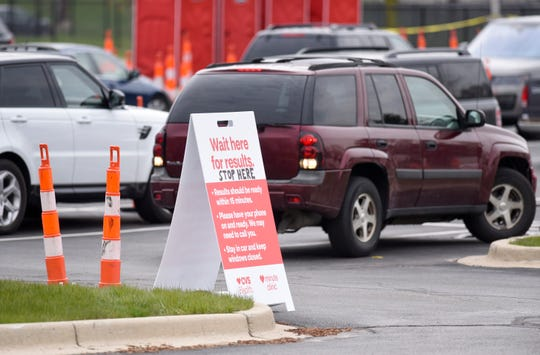 Motorists wait for test results at the CVS drive-thru COVID-19 rapid testing site at 16301 Michigan Ave. in Dearborn, Friday, April 24, 2020.