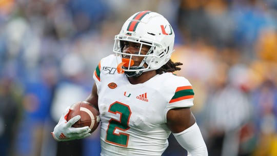 Miami wide receiver K.J. Osborn (2) breaks through tackles after catching a pass to score a touchdown against Pittsburgh during the fourth quarter on, Saturday, Oct. 26, 2019, in Pittsburgh. Miami won 16-12.