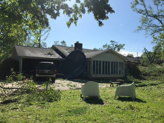 Strong winds blew a trampoline onto the Wildaire home of Jennifer and Benji McGaha. A tree crashed through their dining room and sunroom. April 26,2020