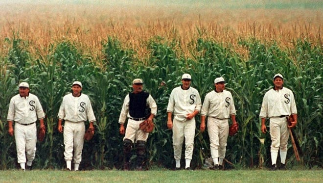 """The ghosts of ballplayers emerge from the cornfields in a scene from the movie """"Field of Dreams."""""""