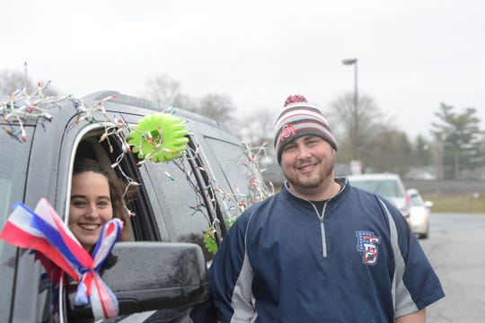 Josh Crosswhite and his wife, Ashley, at the start of the parade in Crestline.