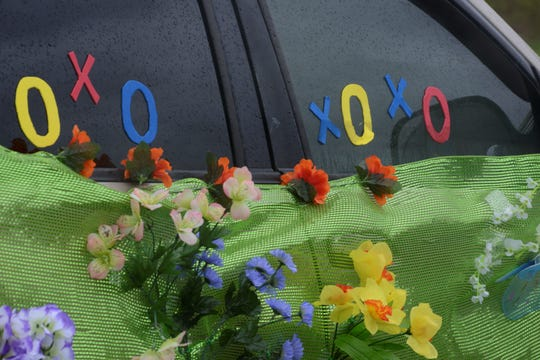 Many cars were decorated with flowers, streamers and signs.