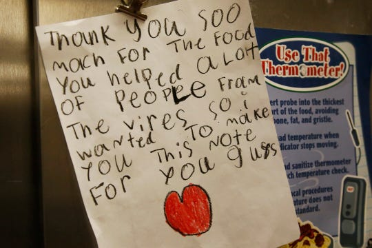 A thank you note hangs in the kitchen of the Prairie Queen Elementary School in Oklahoma City on Monday, April 20, as lunches and instructional packets are distributed.