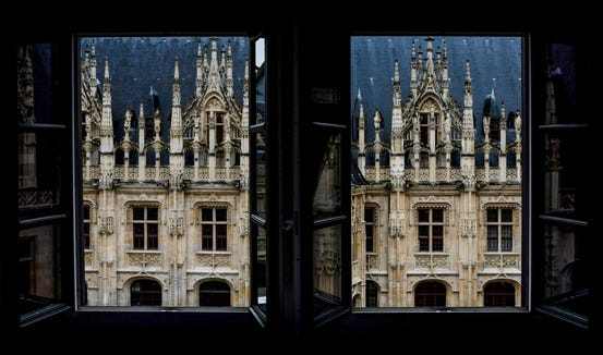 The awesome view from our tiny hotel room in Rouen, France.