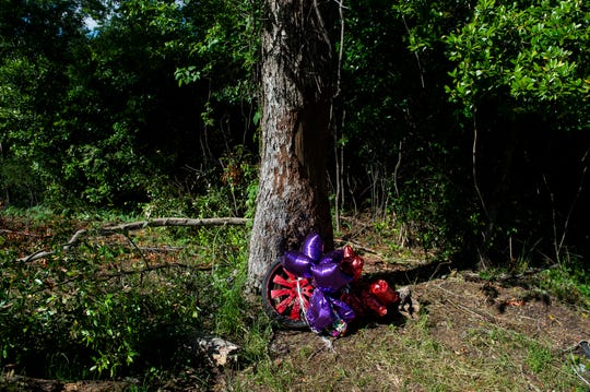 Lakitta Jackson tied balloons around a tire at the scene of her husband, Tarvaris' crash in Pike Road, Ala., on Friday, April 24, 2020. Former NFL Quarterback and Montgomery native Tarvaris Jackson died following a single-car crash April 12.